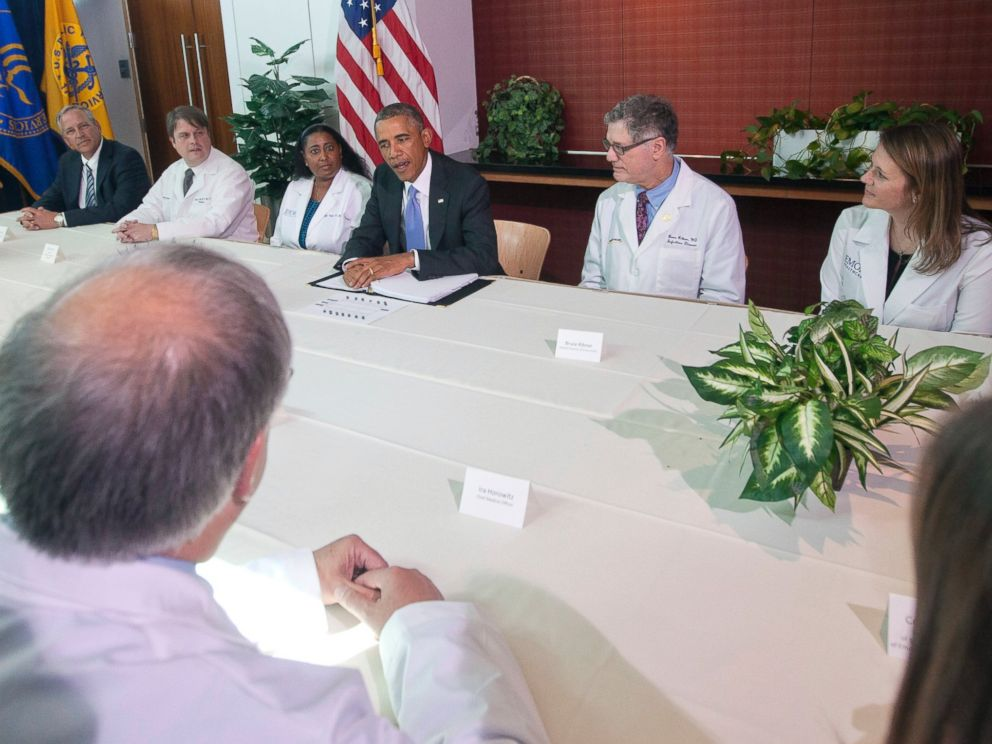 PHOTO: President Barack Obama, center, is pictured with Emory University doctors and healthcare professionals during a CDC meeting on Sept. 16, 2014 in Atlanta, Ga.