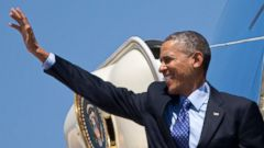 PHOTO: President Barack Obama waves as he boards Air Force One, April 16, 2014, at Andrews Air Force Base, Md.