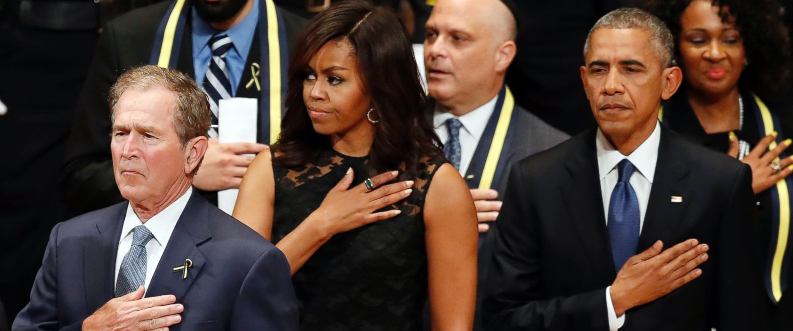PHOTO: Former President George W. Bush, first lady Michelle Obama and President Barack Obama stand during an interfaith memorial service at the Morton H. Meyerson Symphony Center in Dallas, July 12, 2016, in Dallas.