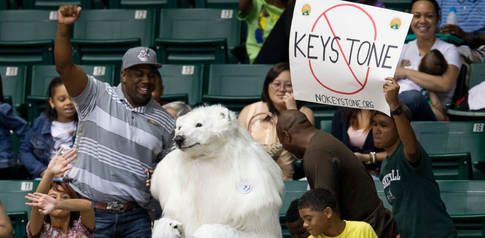PHOTO: A person dressed as a polar bear and others demonstrate against the Keystone Pipeline as President Barack Obama attends the Oregon State University versus University of Akron college basketball game in Honolulu, Dec. 22, 2013.