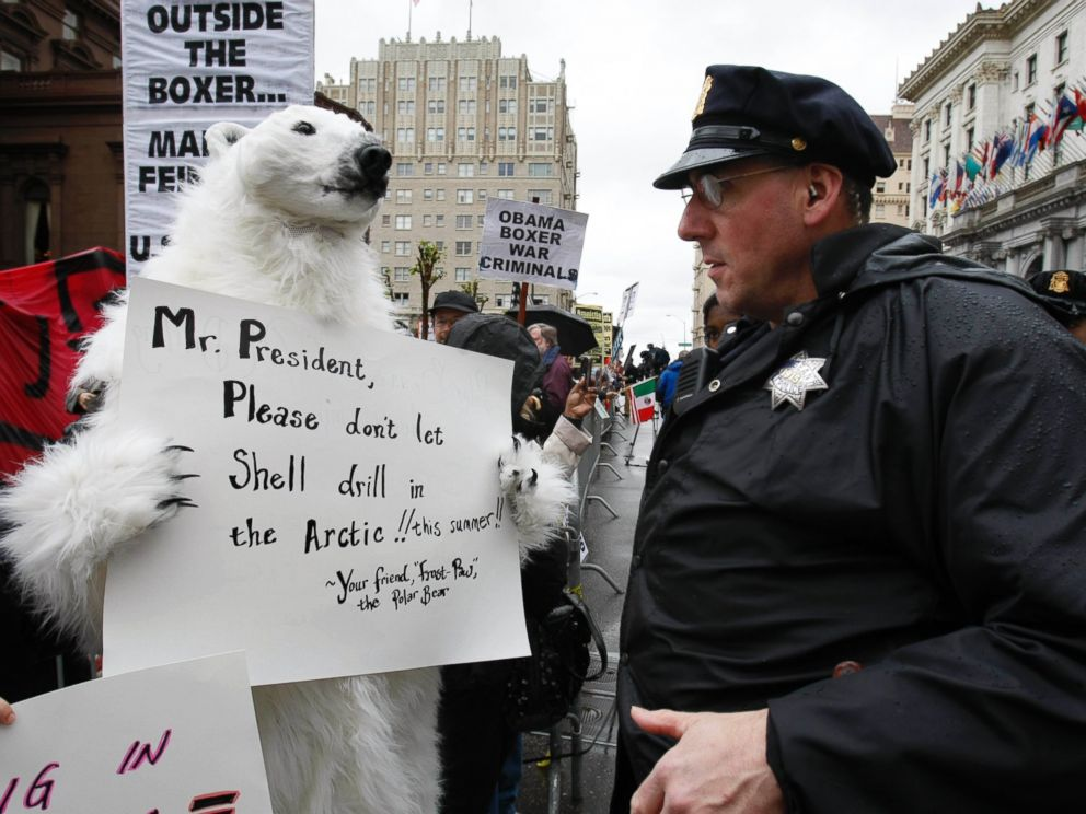PHOTO: A demonstrator in a polar bear outfit talks to a police officer in San Francisco, May 25, 2010, in front of a hotel where President Obama plans to attend for a fund-raising campaign for Sen. Barbara Boxer, D-Calif.