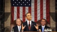 PHOTO: President Barack Obama delivers his State of the Union address on Capitol Hill in Washington, Jan. 24, 2012 as Vice President Joe Biden, back left, and House Speaker John Boehner listen.
