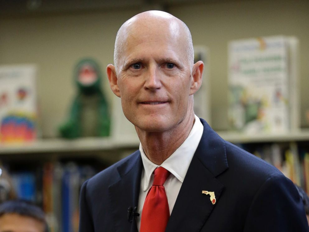 PHOTO: Florida Gov. Rick Scott waits to speak at the Dr. Carlos J. Finlay elementary school, June 1, 2015, in Miami.