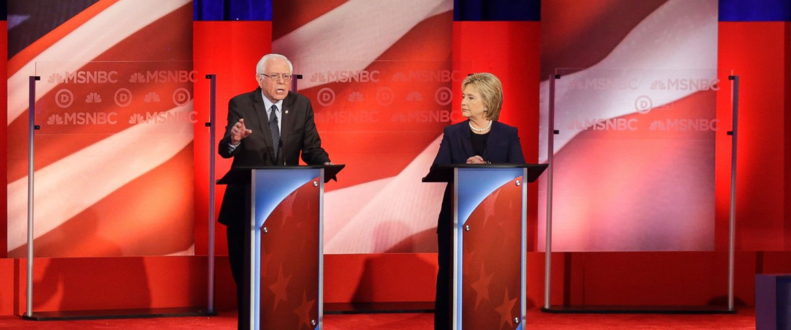 Sen. Bernie Sanders, makes his opening statement as Hillary Clinton listens during a Democratic presidential primary debate at the University of New Hampshire Feb.4, 2016,in Durham, N.H.
