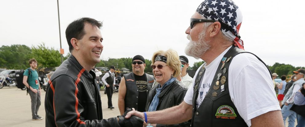 PHOTO: Wisconsin Gov. Scott Walker, left, greets a local rider before a fundraising ride for Sen. Joni Ernst, R-Iowa, Saturday, June 6, 2015, in Des Moines, Iowa.