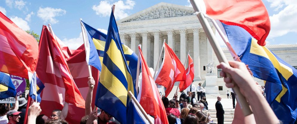 PHOTO: Supporters of marriage equality gather outside the Supreme Court to demonstrate support for LGBT couples, April 28, 2015 in Washington.