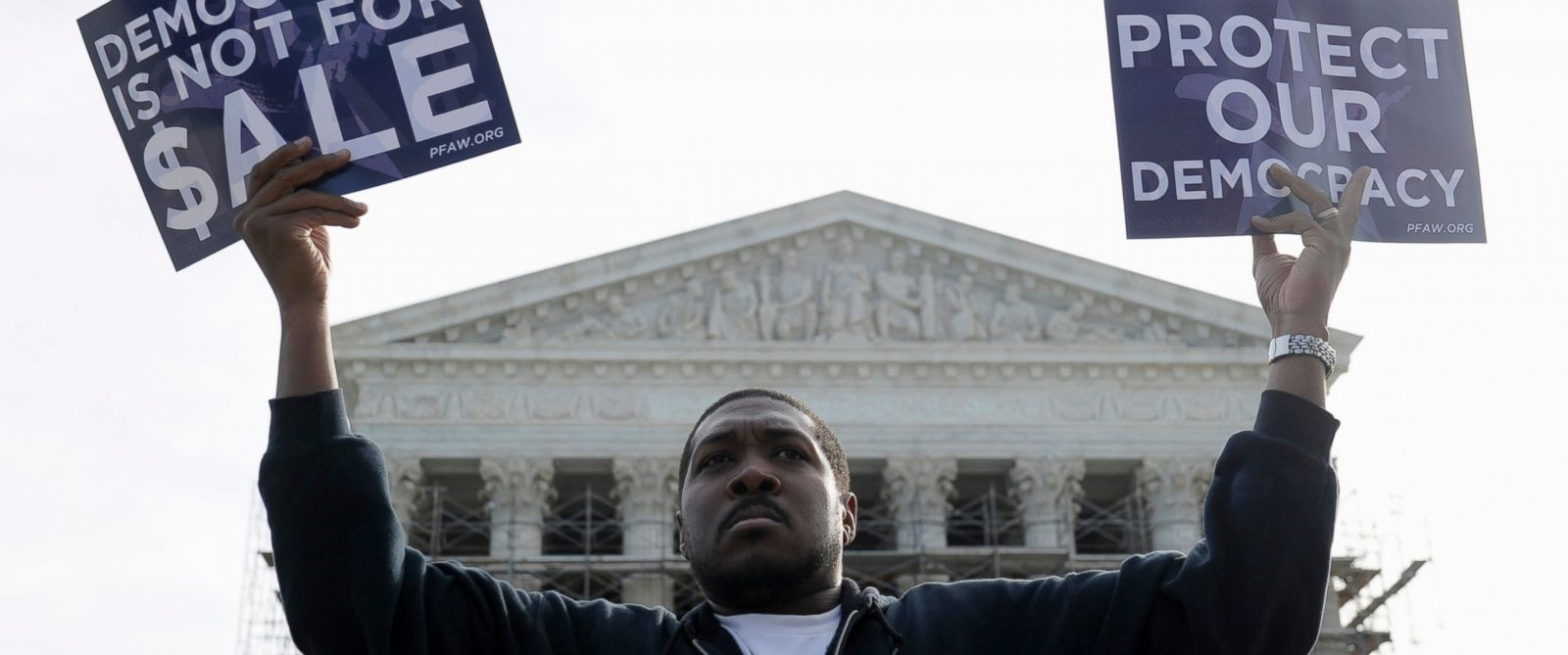 PHOTO: Cornell Woolridge of Windsor Mill, Md., takes part in a demonstration outside the Supreme Court in Washington as the court heard arguments on campaign finance.