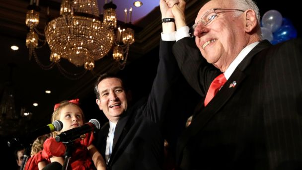 PHOTO: Republican candidate for U.S. Senate Ted Cruz, left, raises his hand with his father Rafael