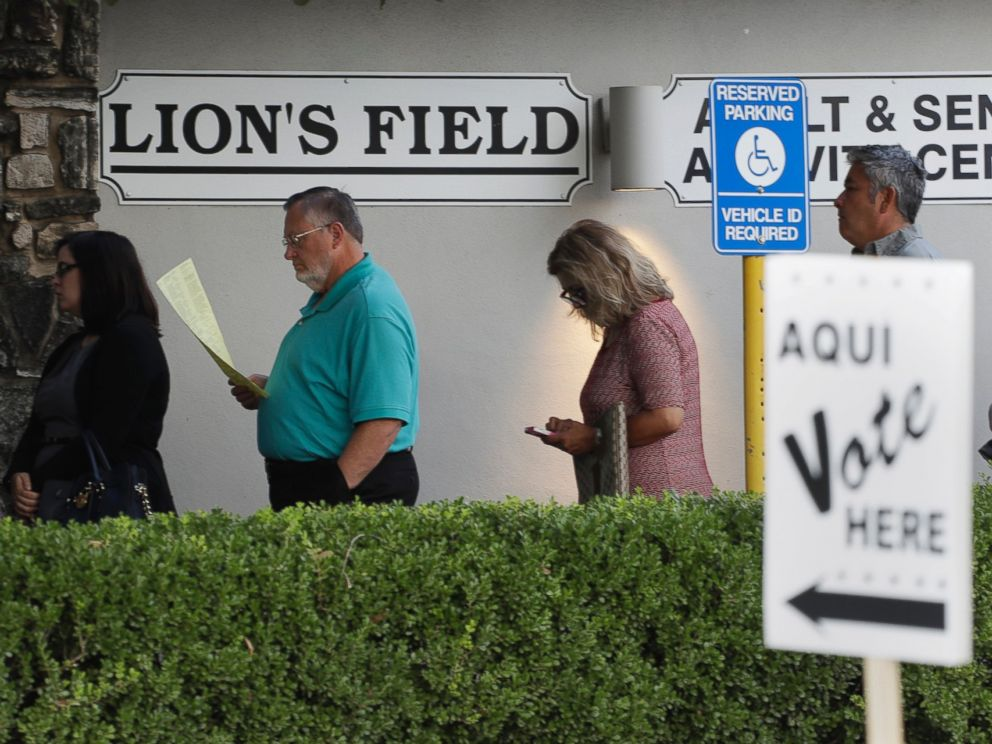 PHOTO: Voters stand in line at an early polling site, Oct. 24, 2016, in San Antonio, Texas.