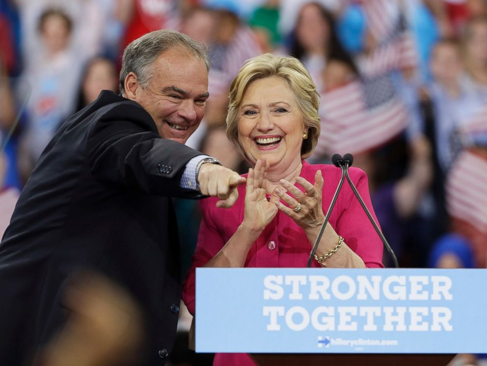 PHOTO: Democratic presidential candidate Hillary Clinton and her running mate, Democratic vice presidential candidate, Sen. Tim Kaine, react after a campaign rally at Temple University, July 29, 2016, in Philadelphia.
