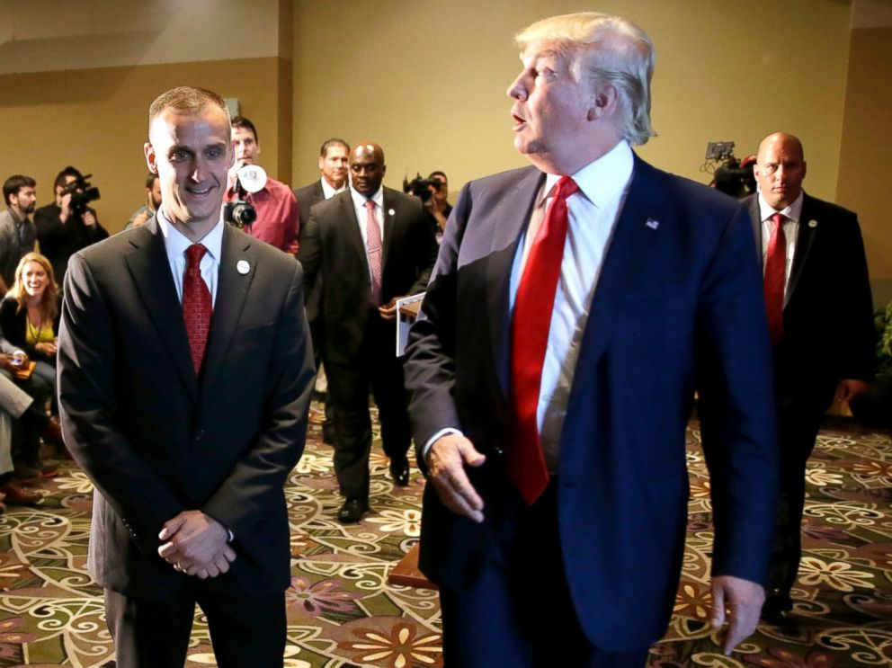 Donald Trump right walks with his campaign manager Corey Lewandowski after speaking at a news conference in Dubuque Iowa Aug. 25 2015