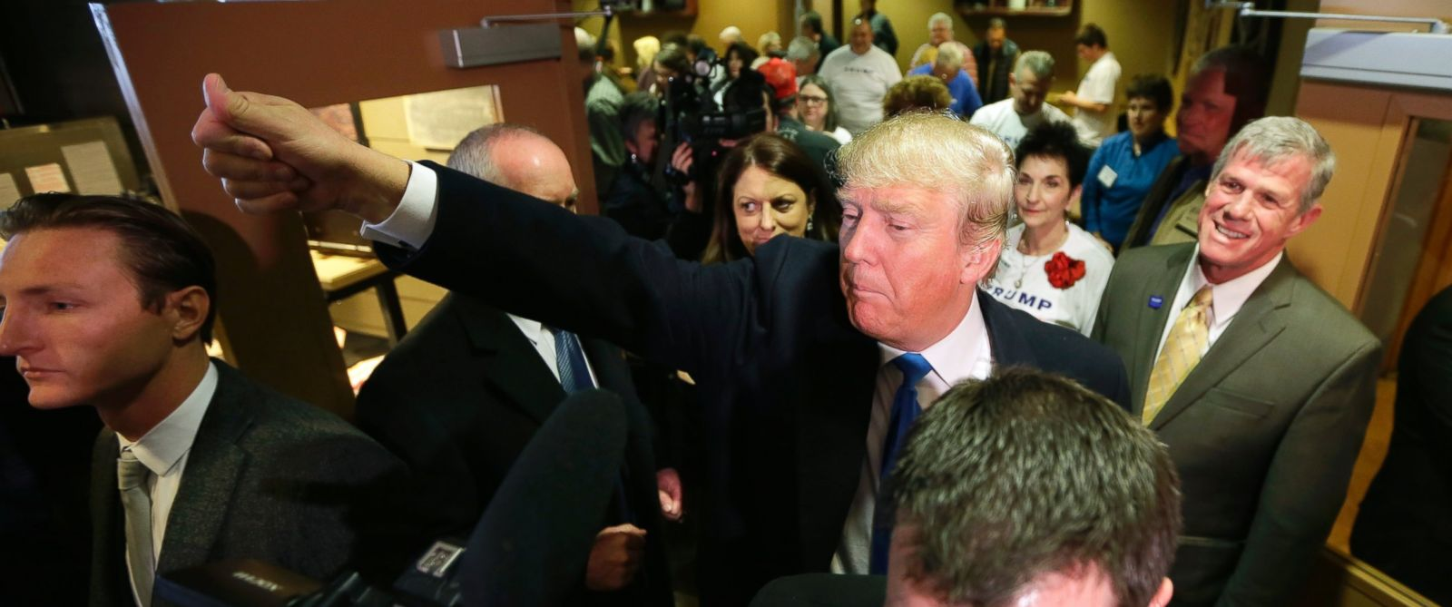PHOTO: Donald Trump waves to supporters after meeting with volunteers at the local Pizza Ranch restaurant on Jan. 15, 2016, in Waukee, Iowa.