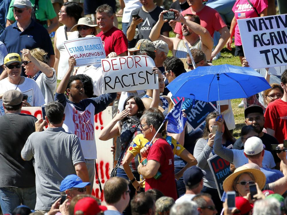 PHOTO:Protesters stand in the crowd of Republican presidential candidate Donald Trump supporters as Trump speaks during a campaign rally, March 19, 2016, in Fountain Hills, Ariz.