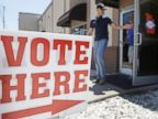 PHOTO: A man leaves an early voting poling place in Lonoke, Ark., May 5, 2014.