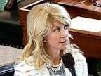 PHOTO: Sen. Wendy Davis, D-Fort Worth, stands on a near empty senate floor as she filibusters in an effort to kill an abortion bill, June 25, 2013, in Austin, Texas.
