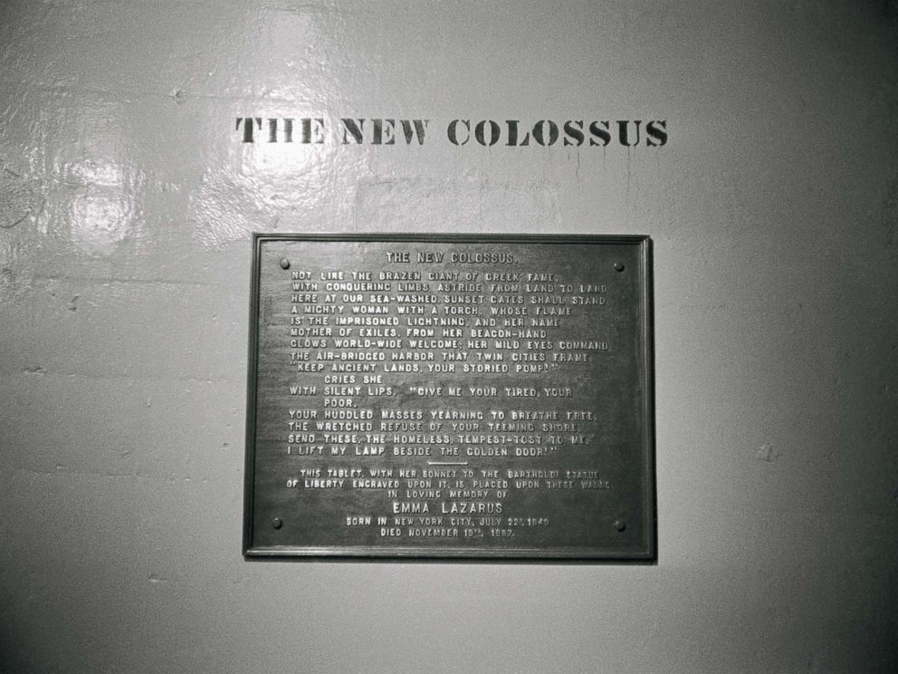 PHOTO: A plaque with a poem entitled The New Colossus by Emma Lazarus located on the base of the Statue of Liberty.