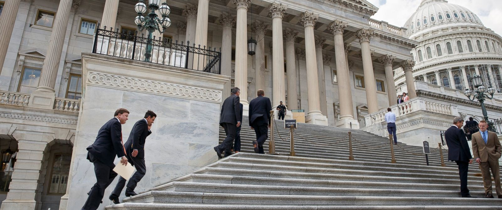 PHOTO: Members Congress clinb the steps of the House of Representatives for final votes, at the Capitol in Washington, Thursday, July 31, 2014.