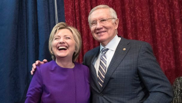 PHOTO: Former Secretary of State Hillary Clinton stands beside Senate Minority Leader Harry Reid, at the unveiling of a portrait of Reid, on Capitol Hill in Washington, Dec. 8, 2016.