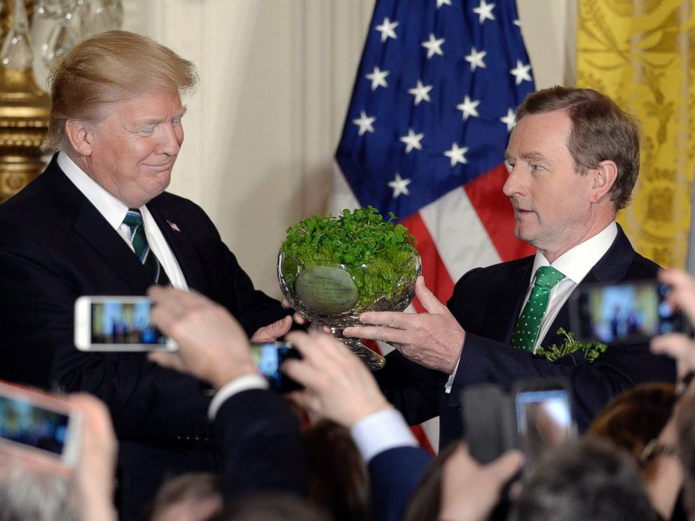 PHOTO: President Donald Trump, accepts a bowl of shamrocks from Enda Kenny, Irelands prime minister during a reception in the East Room of the White House in Washington, March 16, 2017.
