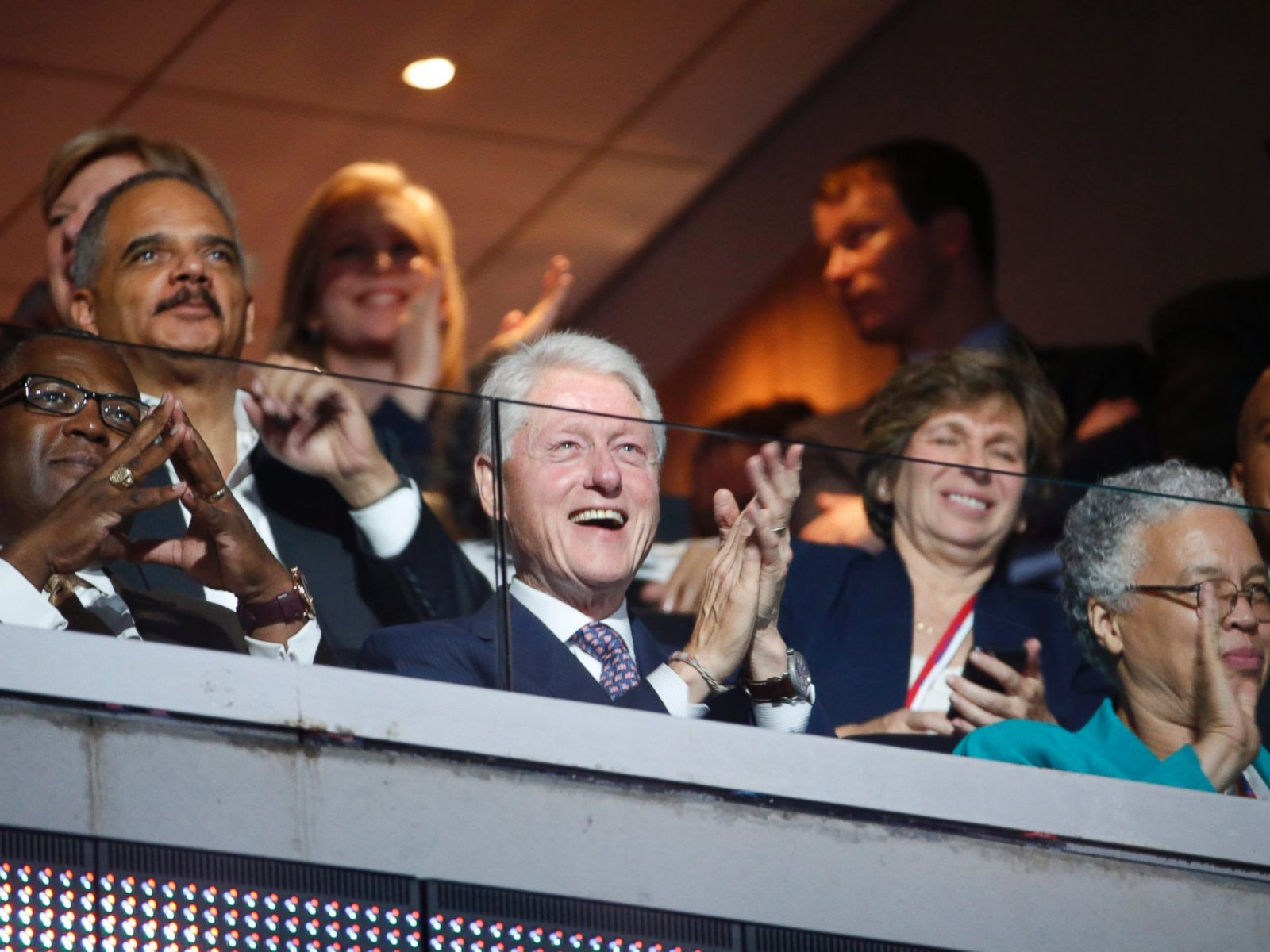 PHOTO: Former US President Bill Clinton listens as US First Lady Michelle Obama delivers remarks in the Wells Fargo Center on the first day of the 2016 Democratic National Convention (DNC) in Philadelphia, July 25, 2016.