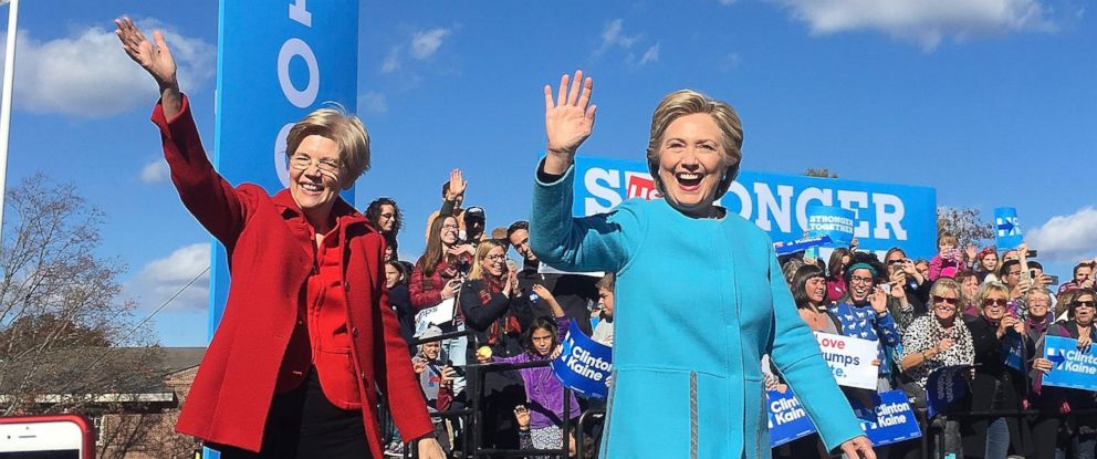 PHOTO: U.S. Senator Elizabeth Warren (L) and Democratic Candidate for U.S. President Hillary Clinton (R) wave as they arrive to a campaign rally at St. Anselm College in Manchester, New Hampshire, on Oct. 24, 2016.
