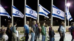 PHOTO: Israelis stand in line near flags at half mast as they wait to pay their respects to Shimon Peres, Israels elder statesman, at the Knesset (Parliament) in Jerusalem, Sept. 29, 2016.