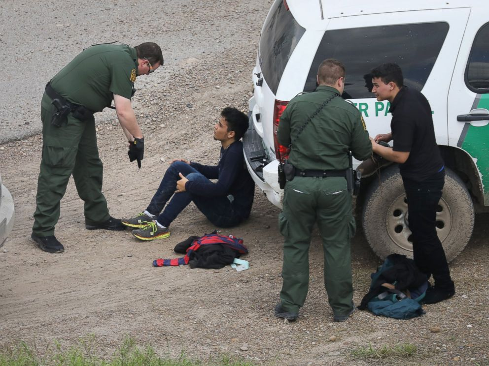 PHOTO: U.S. Border Patrol agents detain two undocumented immigrants after capturing them near the U.S. and Mexico border, on March 15, 2017, near McAllen, Texas.