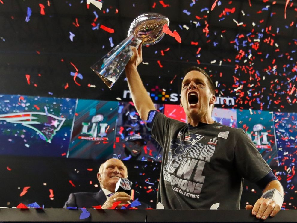 PHOTO: Quarterback Tom Brady of the New England Patriots raises the Vince Lombardi Trophy after defeating the Atlanta Falcons during Super Bowl 51, February 5, 2017 in Houston, Texas.