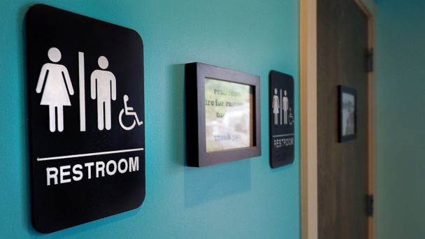 PHOTO: Unisex signs hang outside bathrooms at a restaurant in Durham, N.C. on May 10, 2016.