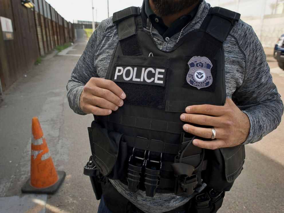 PHOTO: A U.S. Immigration and Customs Enforcement (ICE) agent waits as an undocumented man, not pictured, is deported to Mexico at the U.S. and Mexico border in San Diego, Calif., on Feb. 26, 2015.