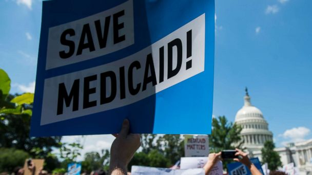 PHOTO: Participants hold signs during the Senate Democrats' rally against Medicaid cuts in front of the U.S. Capitol on June 6, 2017.