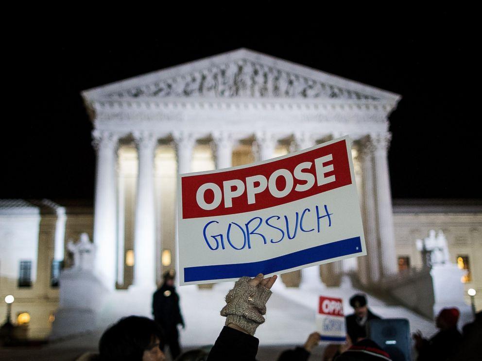 PHOTO: Protestors gather outside of the Supreme Court, Jan. 31, 2017, in Washington.