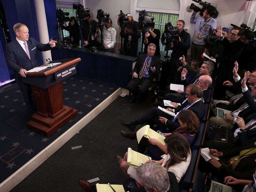 PHOTO: White House Press Secretary Sean Spicer (L) takes questions during a daily briefing at the James Brady Press Briefing Room of the White House January 23, 2017 in Washington.