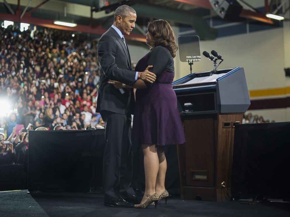 PHOTO: President Barack Obama hugs Astrid Silva, an activist, as he arrives to deliver remarks on the new steps he will be taking within his executive authority on immigration at Del Sol High School in Las Vegas, Nov. 21, 2014.