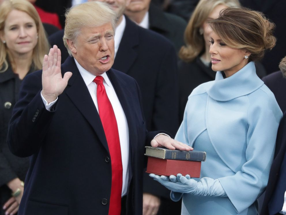 PHOTO: (L-R) President Donald Trump takes the oath of office as his wife Melania Trump holds the bible and his son Barron Trump looks on, on the West Front of the U.S. Capitol, Jan. 20, 2017 in Washington, D.C.