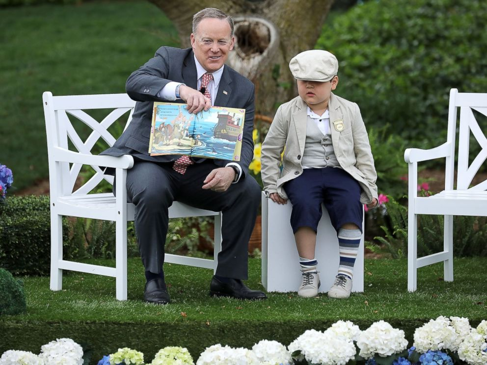 PHOTO: White House press secretary Sean Spicer reads the childrens book How To Catch The Easter Bunny during the 139th Easter Egg Roll on the South Lawn of the White House, April 17, 2017, in Washington.