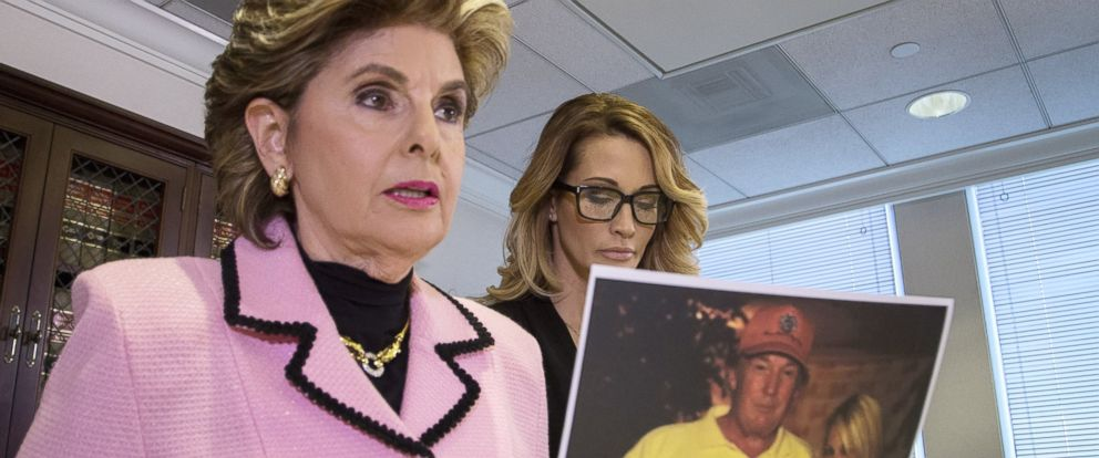 PHOTO: Attorney Gloria Allred holds a photo of Jessica Drake (R) with Donald Trump, taken in 2006, Oct. 22, 2016 in Los Angeles.