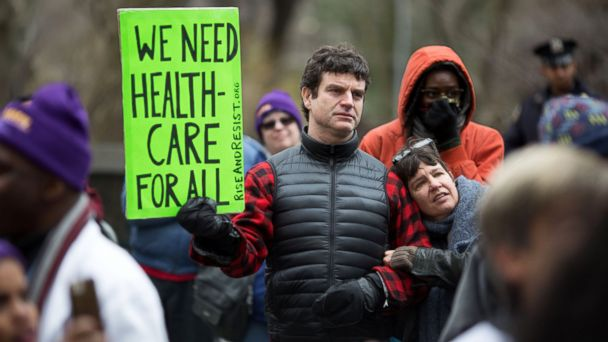 PHOTO: Health care demonstrators promote the Affordable Care Act during a rally as part of the national