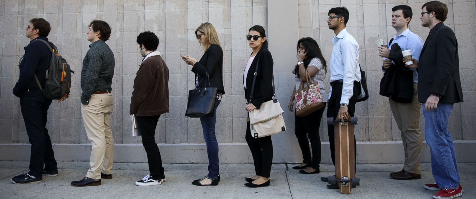 analysis retail takes a hit in disappointing jobs report abc news photo job seekers wait in line during the techfair la job fair in los angeles