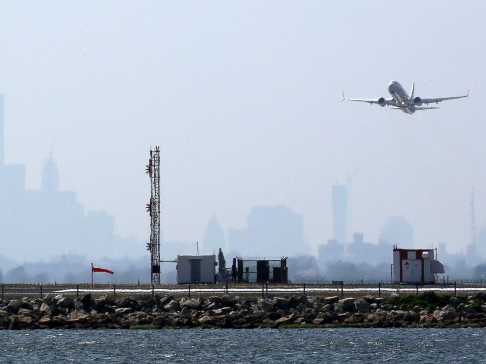 PHOTO: An aircraft takes off from New Yorks John F. Kennedy Airport against a hazy backdrop of the New York skyline, May 25, 2015.