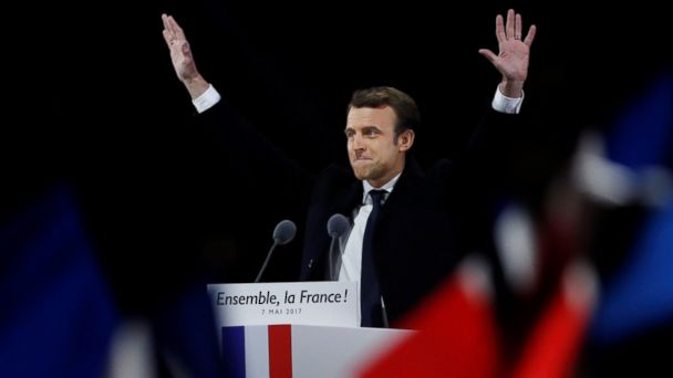 PHOTO: French president-elect Emmanuel Macron waves to the crowd as he delivers a speech at the Pyramid at the Louvre Museum in Paris, May 7, 2017, after the second round of the French presidential election.