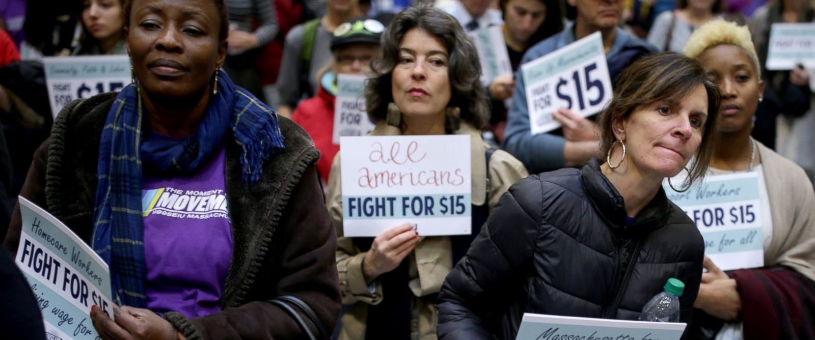PHOTO: Hilda Haye, left and Lisa Murphy, right, who are from Cape Cod, take part in a National Day of Action 15 dollar per hour minimum wage protest at the Massachusetts State House in Boston, Nov. 29, 2016.
