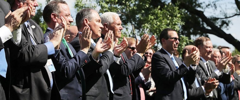 PHOTO: Vice President Mike Pence and others applaud as President Donald Trump announces his decision to withdraw the U.S. from the Paris climate agreement at the White House, June 1, 2017.