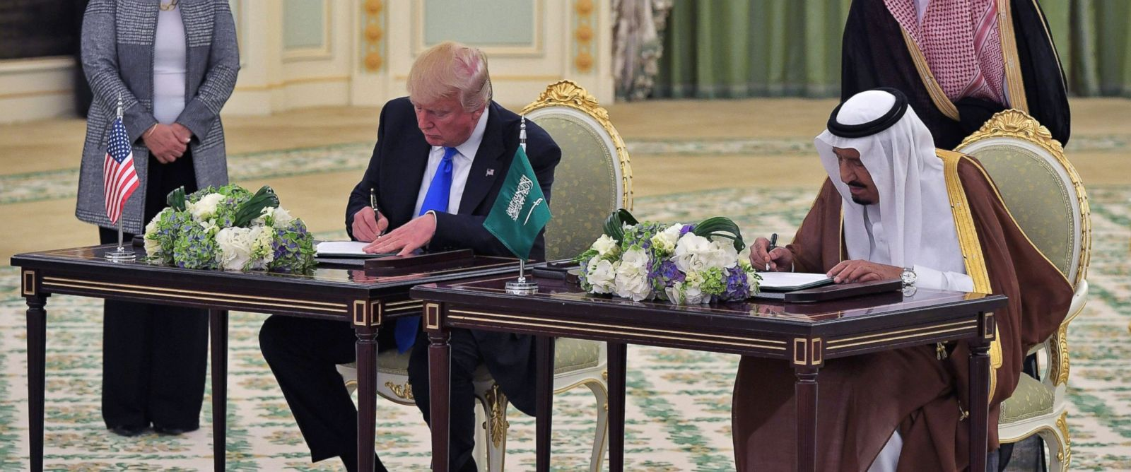 Image result for trump signs arms deal with saudi arabia