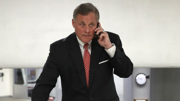 PHOTO: Sen. Richard Burr speaks on his mobile phone while walking to the weekly Republican caucus luncheon at the Capitol, Feb. 14, 2017 in Washington, D.C.