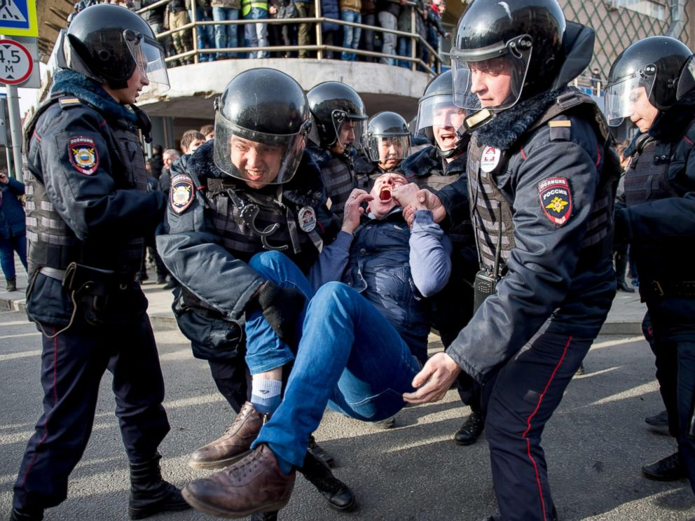 PHOTO: Riot police officers detain a protester during a rally in central Moscow, March 26, 2017.