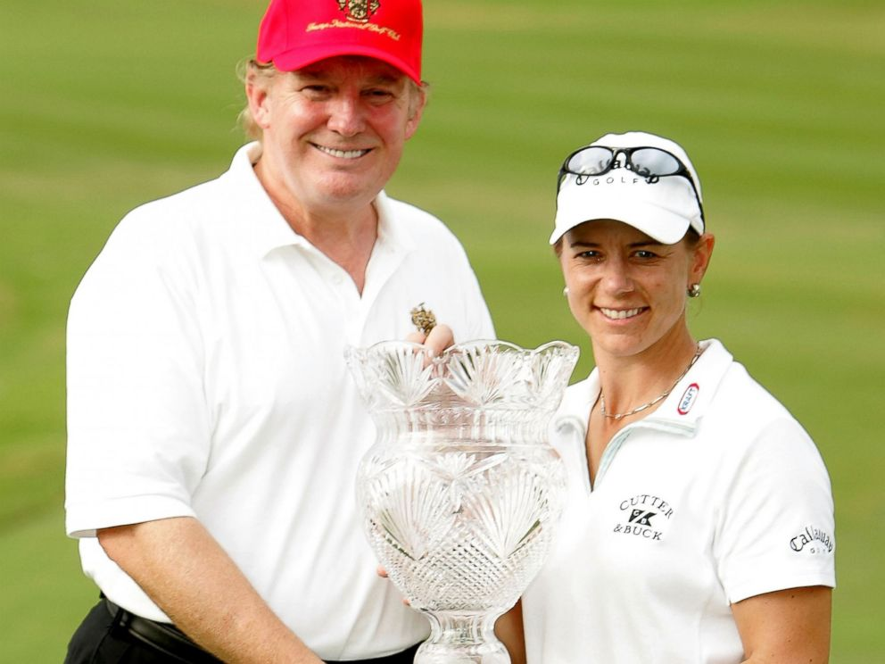 PHOTO: Annika Sorenstam of Sweden poses with Donald Trump and the trophy on the 18th green at the Trump International Golf Club, Nov. 21, 2004, in West Palm Beach, Florida.