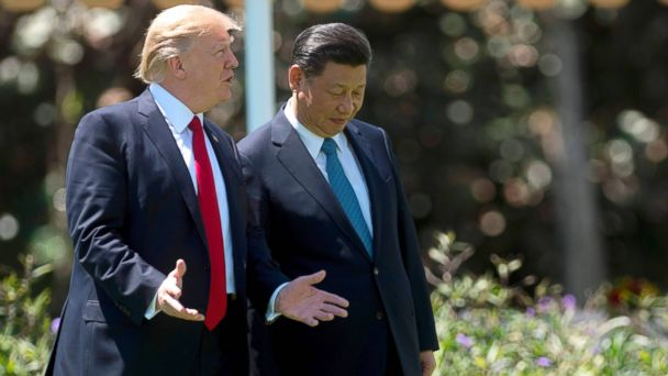 PHOTO: President Donald Trump and Chinese President Xi Jinping walk at the Mar-a-Lago estate in West Palm Beach, Fla., April 7, 2017.