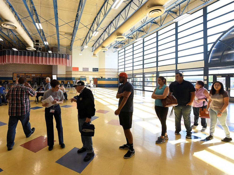 PHOTO: Voters are greeted at Cheyenne High School as they arrive to cast their ballots on Election Day, Nov. 8, 2016, in North Las Vegas, Nevada.