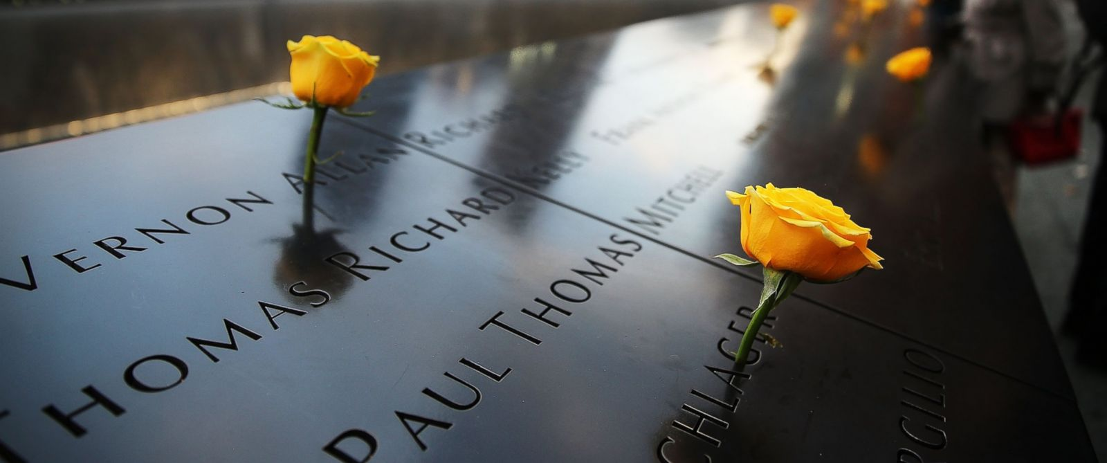 PHOTO: Flowers adorn the 9/11 Memorial for Veterans Day on Nov. 11, 2014 in New York City.